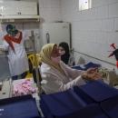 تصاویر کارگاه مردمی تولید ماسک در سنندج