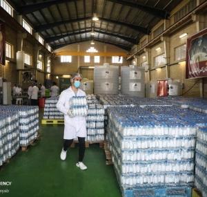 تصاویر مرحله دوم توزیع ۱۵۰ هزار بطری محلول ضدعفونی کننده